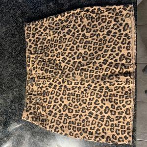A Leopard Siera Cutoff Mini Skirt from Guess